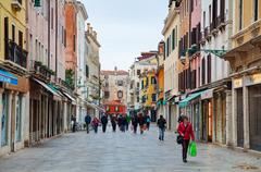 Crowded with tourists street in Venice - stock photo