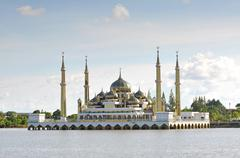 Beautiful crystal mosque with blue sky and clouds at Terengganu, Malaysia Stock Photos