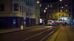 Tram stopped at station at night - stock footage