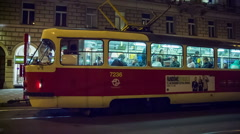 Tram take of from station at night Stock Footage