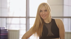 Portrait of a fitness trainer and yoga, smiling clean bright smile at the camera Stock Footage