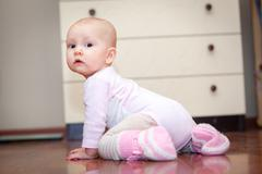 small child on the floor, who was crying, but does not scream. A tear rolling - stock photo