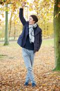 Young man relaxing outdoors on an Autumn day - stock photo