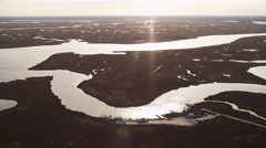 Over wide marshland west of Atlantic City, New Jersey. Shot in November 2011. Stock Footage