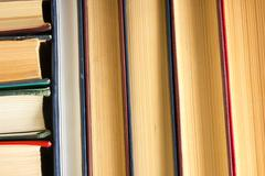 Top view of old used colorful hardback books. Back to school - stock photo