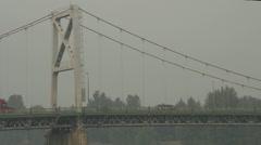 Suspension bridge, general transport trucks, long shot Stock Footage