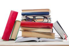 Stack of books at wooden shelf isolated on white background. Back to school - stock photo