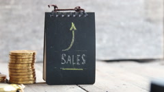 SALES word, coins and arrow - stock footage