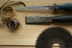 Carpenter tools on wooden table with sawdust - stock photo
