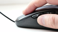 Hand and computer mouse close-up Stock Footage