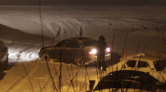 The Car is Parked in the Winter in Bad Weather Stock Footage