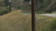 Fire truck arriving, rural road, follow shot Stock Footage