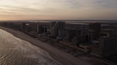 Flying past beach resorts at the southwest end of Atlantic City, New Jersey. - stock footage