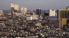 Flying over downtown Atlantic City, New Jersey, looking toward casino resorts. - stock footage