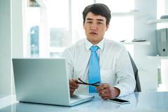 Portrait of serious asian businessman - stock photo
