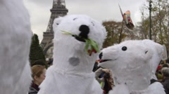 Demonstrators in polar bear suits at COP21 climate change rally Stock Footage