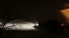 Cars are going in the Night in Winter on Snow-Covered Roads Stock Footage