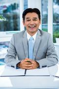 Portrait of smiling asian businessman - stock photo