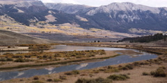 Timelapse of a winding river in Green River Valley and Wind River Mountain Range Stock Footage