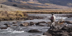 Fly fisherman casting into a river at Green River Valley in Wyoming Stock Footage