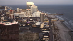 Flying past casino resorts along the Boardwalk in Atlantic City, New Jersey. - stock footage