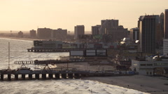 Leaving Atlantic City, New Jersey, looking back at casino resorts and amusement - stock footage
