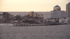 Leaving Atlantic City, New Jersey, looking back at resorts and amusement park on - stock footage