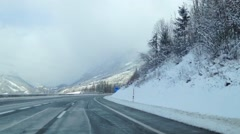 Winter snow slush winter slippery road motorway in Austria, Alps Salzburg Stock Footage