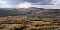 Timelapse storm clouds over scrublands landscape in Green River Valley, Wyoming Stock Footage