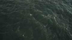 Over open ocean off the New Jersey coast. at 200 feet elevation. No horizon. - stock footage