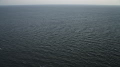 Over open ocean off the New Jersey coast at 200 feet elevation. Shot in November - stock footage