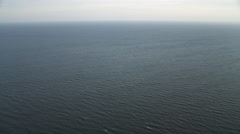 Over open ocean off the New Jersey coast at 1000 feet elevation. Shot in - stock footage