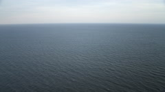 Over open ocean off the New Jersey coast, descending from 1000 feet to 100 feet. - stock footage