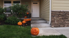 Homes entryway decorated for Halloween with jack-o-lanterns - stock footage