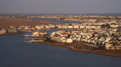 Past densely populated barrier islands off the New Jersey Coast, looking toward - stock footage