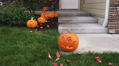 Homes entryway decorated for Halloween with jack-o-lanterns Stock Footage