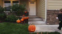 Children trick or treating Stock Footage