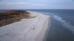 Low fast flight above beach and surf, heading for Beach Haven, New Jersey. Shot Stock Footage
