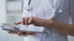 Close-up of hands of the young nurse working with the tablet Stock Footage