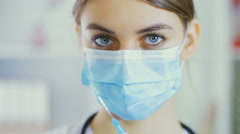 Portrait of the young nurse who holds a syringe in hand Stock Footage