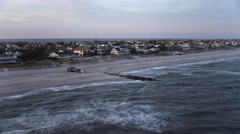Flying past beach houses on Long Beach Island, New Jersey at dusk. Shot in Stock Footage