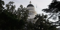 Dome of the California State Capitol framed by trees Stock Footage