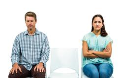 Stock Photo of Sad couple not talking after argument