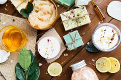 close up of body care cosmetic products on wood - stock photo