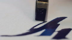 Painter drawing calligraphy artwork macro - stock footage