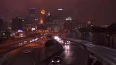 City traffic entering and leaving Minneapolis at night 4k Stock Footage
