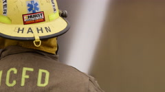 Close view of firefighter spraying a blaze - stock footage