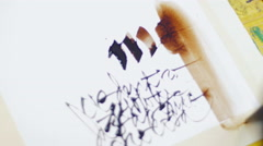 Painter drawing stylish calligraphy closeup Stock Footage