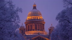 Saint Isaac's Cathedral dome illuminated at night, cold winter Stock Footage