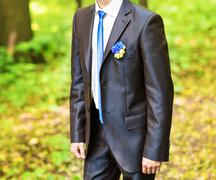 groom in a park on their wedding day - stock photo